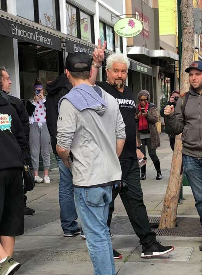 "Chef and Santa Rosa resident Guy Fieri was ""keepin it local"" this week, and visited a few local spots while filming ""Diners, Drive-Ins and Dives."" Pictured is Fieri leaving Scolari's in Alameda. Photo: Courtesy Bryant Vock"