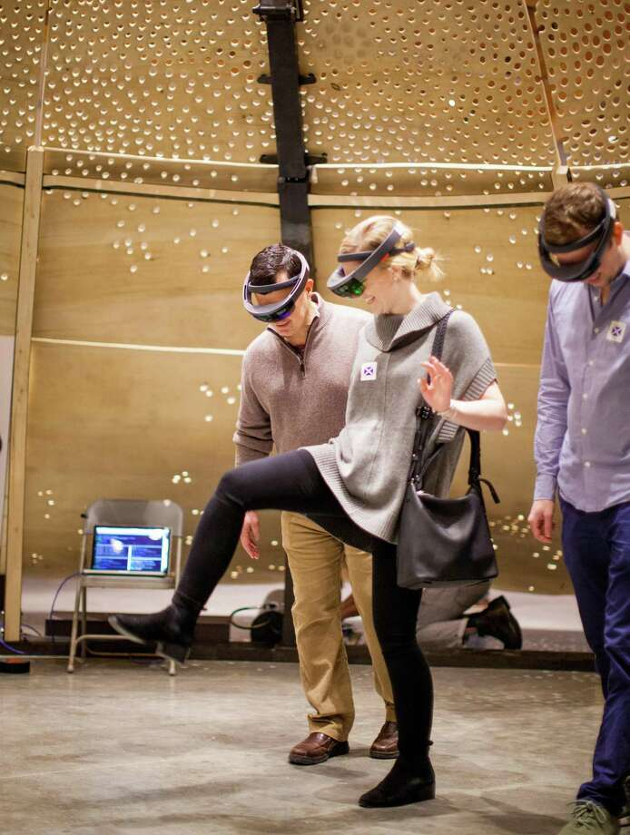 Visitors climb a virtual Arctic pingo (Alaskan ice hill) using Microsoft HoloLens headsets at a new temporary exhibition at Mystic Seaport. Photo: Mystic Seaport / Joe Michael / Contributed Photo / ©Mystic Seaport. Photo: Joe Michael