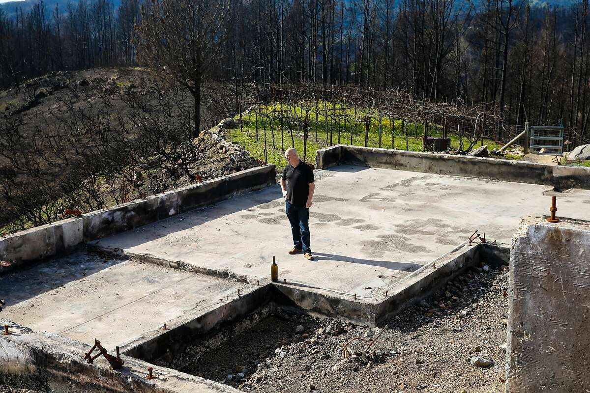 Per Rosdahl stands on the foundation where his home stood before the Tubbs fire destroyed his entire property in October 2017. Wednesday, Jan. 31, 2018 in Knights Valley, Calif.