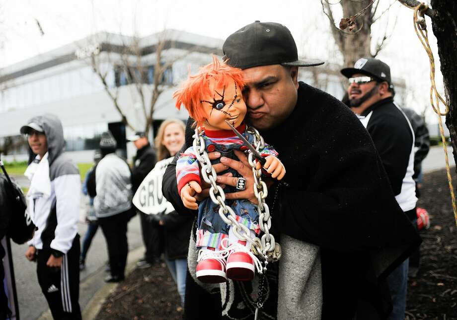 A fan holds up a Chucky doll before a Jon Gruden news conference in Alameda last year. Photo: Icon Sportswire, Icon Sportswire Via Getty Images