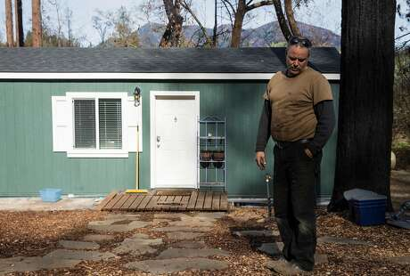 Bud Pochini's stands near his temporary modular home in his yard Wednesday, Jan. 31, 2018 in Knights Valley, Calif.