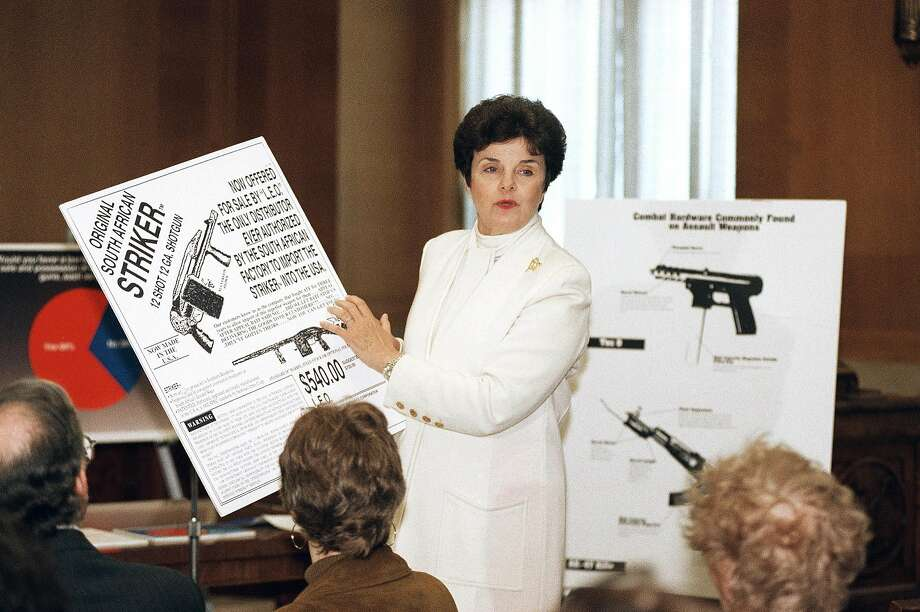 Sen. Dianne Feinstein, D-Calif., holds up an advertisement for a 12-gauge Striker shotgun during a news conference on Capitol Hill to discuss restrictions on assault weapons in 1994. Photo: John Duricka, ASSOCIATED PRESS