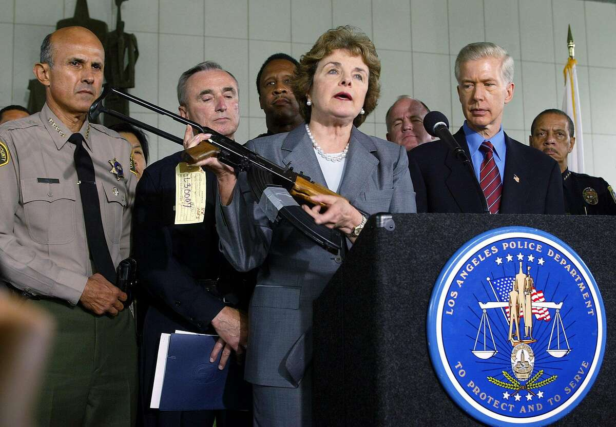 California Senator Diane Feinstein, center, holds up a Chinese made AK-47 as Los Angeles County Sheriff Lee Baca, left, Los Angeles Police Chief William Bratton, Santa Monica Police Chief James T. Butts Jr., and California Governor Gray Davis, right, look on at a news conference in downtown Los Angeles Thursday, Aug. 21, 2003. The group urged Congress to re-authorize the assault weapons ban signed into law in 1994. (AP Photo/Damian Dovarganes)