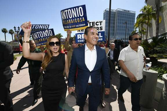 Democratic gubernatorial candidate and former Los Angeles Mayor Antonio Villaraigosa, center, and his wife Patricia Govea, left, walk after a campaign rally held during the 2018 California Democrats State Convention Saturday, Feb. 24, 2018, in San Diego. (AP Photo/Denis Poroy)