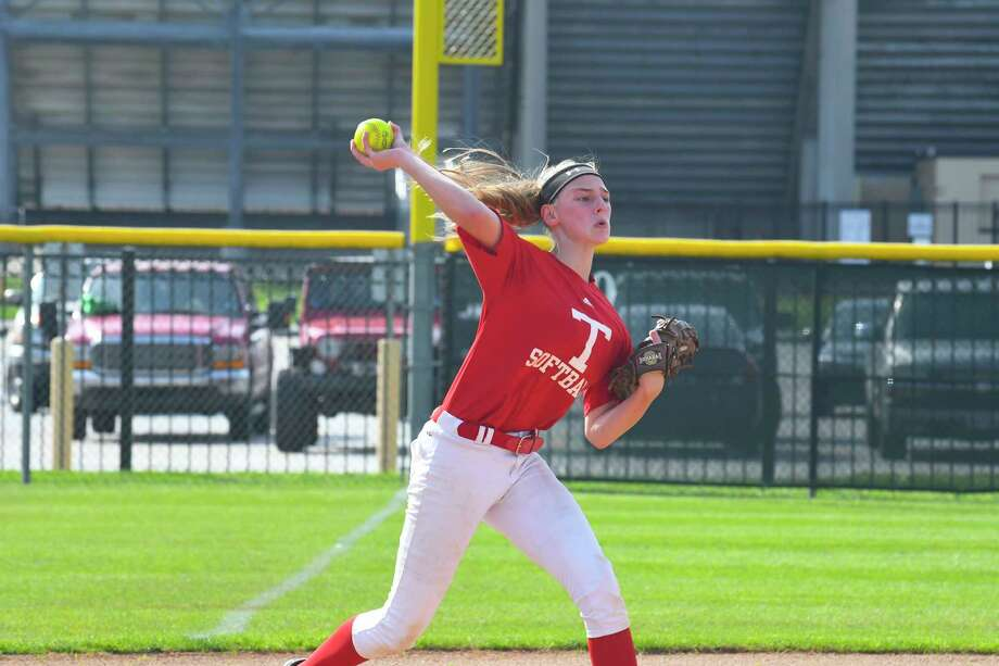 Tomball freshman 3B Amanda Skivington, likely to bat cleanup, practices taking grounders and making throws to a specific base. Photo: Tony Gaines/ HCN, Staff / Houston Chronicle
