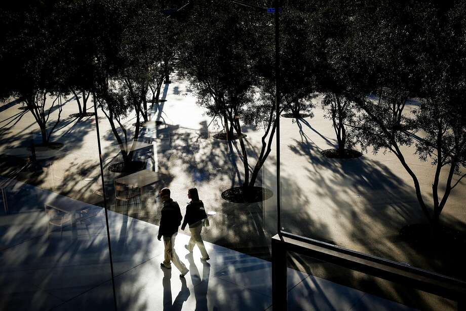 People stroll around the visitor center at Apple Park, the only place in the Cupertino complex that is open to outsiders. Photo: Gabrielle Lurie, The Chronicle