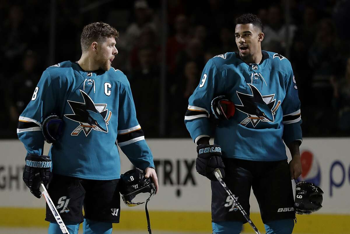 San Jose Sharks' Joe Pavelski, left, talked to teammate Evander Kane during an NHL hockey game against the Chicago Blackhawks Thursday, March 1, 2018, in San Jose, Calif. (AP Photo/Marcio Jose Sanchez)