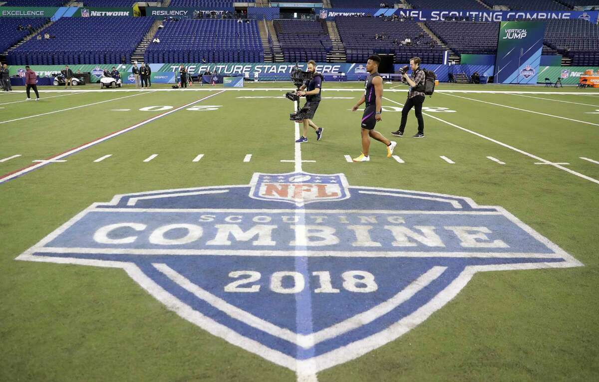 Penn State running back Saquon Barkley walks to the start line for the 40-yard dash at the NFL football scouting combine, Friday, March 2, 2018, in Indianapolis. (AP Photo/Darron Cummings) SLIDESHOW: John McClain picks five winners and five losers from the 2018 NFL combine in Indianapolis.