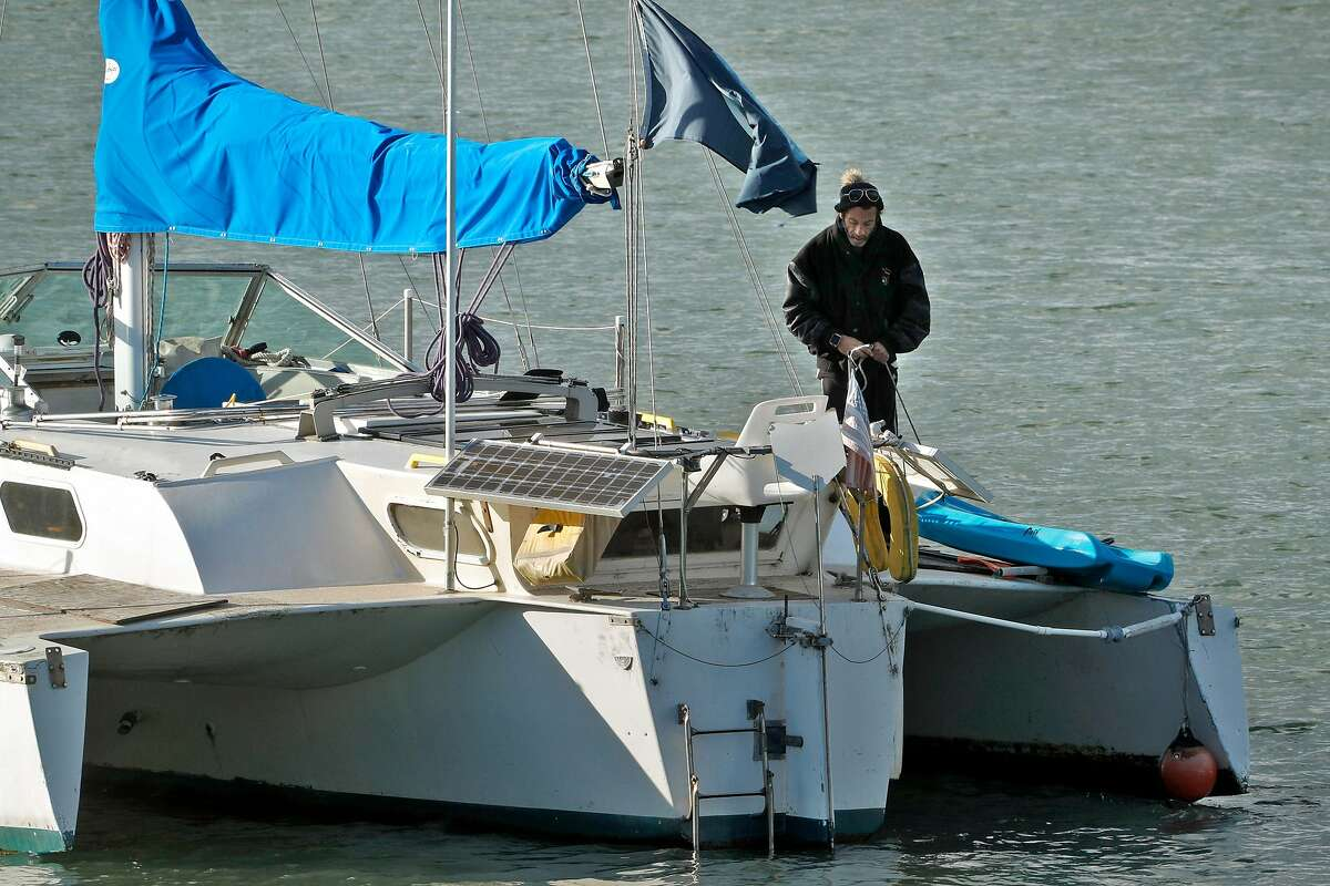 Bryan Pennington on his trimaran anchored just off the beach at Aquatic Park in San Francisco, Calif., on Monday, February 26, 2018. For months there has been a trimaran sailboat illegally anchored in Aquatic Park by Pennington who is living aboard. The Dolphin Club has been trying to get rid of him because he is polluting the bay and interfering with their swimming area. The Dolphin Club took the matters to the Presidio police, which has jurisdiction and they had a hearing in federal court.