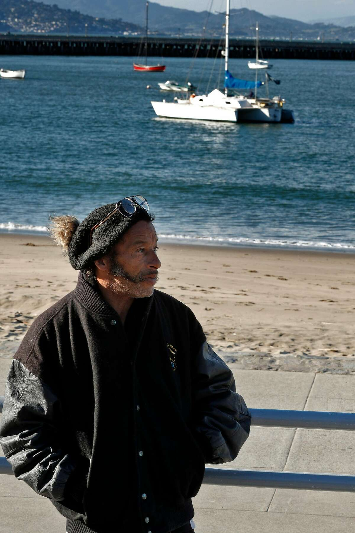 Bryan Pennington stands near the bleachers off the beach at Aquatic Park in San Francisco, Calif., on Monday, February 26, 2018. For months there has been a trimaran sailboat illegally anchored in Aquatic Park by Pennington who is living aboard. The Dolphin Club has been trying to get rid of him because he is polluting the bay and interfering with their swimming area. The Dolphin Club took the matters to the Presidio police, which has jurisdiction and they had a hearing in federal court.