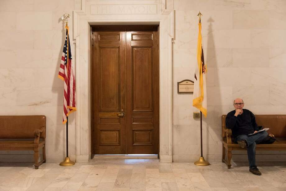 David Lockmiller waits outside the S.F. Mayor Mark Farrell's office to air his concerns about food safety on the first day of the mayor's citizen meetings. Photo: Rosa Furneaux, Special To The Chronicle