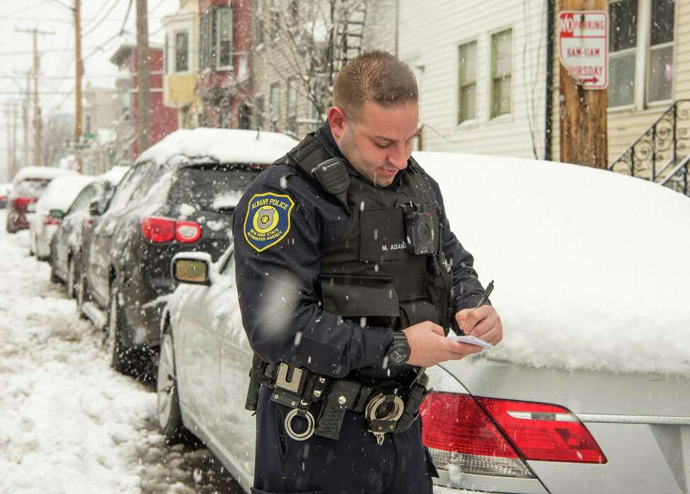 An Albany police officer on patrol during the snow storm on March 2, 2018.