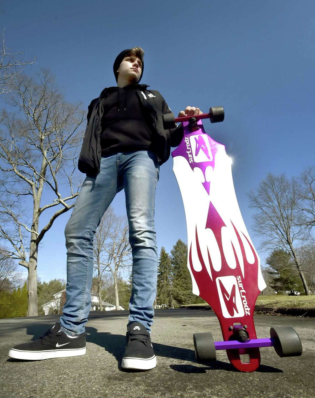 Ryan Casolino, 16, of Branford, models longboard skateboard trucks, hanger, bushings, and baseplate manufactured by Surf-Rodz at JV Precision in Seymour.