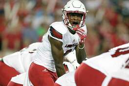 Louisville Cardinals quarterback Lamar Jackson calls out a play during the first half of college football game action against the University of Houston at TDECU Stadium Nov. 17, 2016, in Houston.