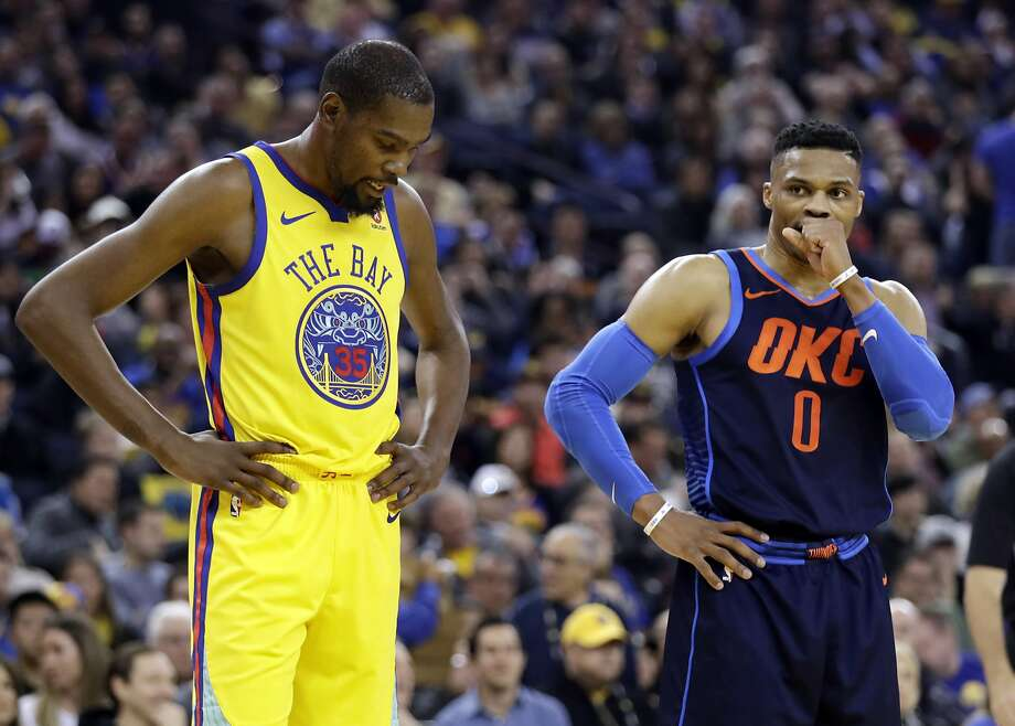 Golden State Warriors' Kevin Durant, left, stands next to Oklahoma City Thunder's Russell Westbrook during the first half of an NBA basketball game Saturday, Feb. 24, 2018, in Oakland, Calif. (AP Photo/Marcio Jose Sanchez) Photo: Marcio Jose Sanchez, Associated Press