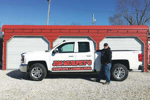 """Complete Landscaping owner Jim """"Chief"""" Murphy, an avid Kansas City Chiefs fan, is easy to spot in his custom signature pickup truck. The business officially opens for the season Monday, March 12, but now is accepting appointments."""