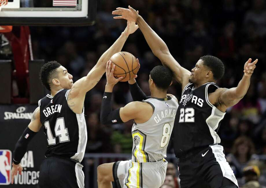 San Antonio Spurs' Danny Green (14) and San Antonio Spurs' Rudy Gay (22) defend against Cleveland Cavaliers' Jordan Clarkson (8) in the first half of an NBA basketball game, Sunday, Feb. 25, 2018, in Cleveland. (AP Photo/Tony Dejak) Photo: Tony Dejak, STF / Associated Press / AP 2018