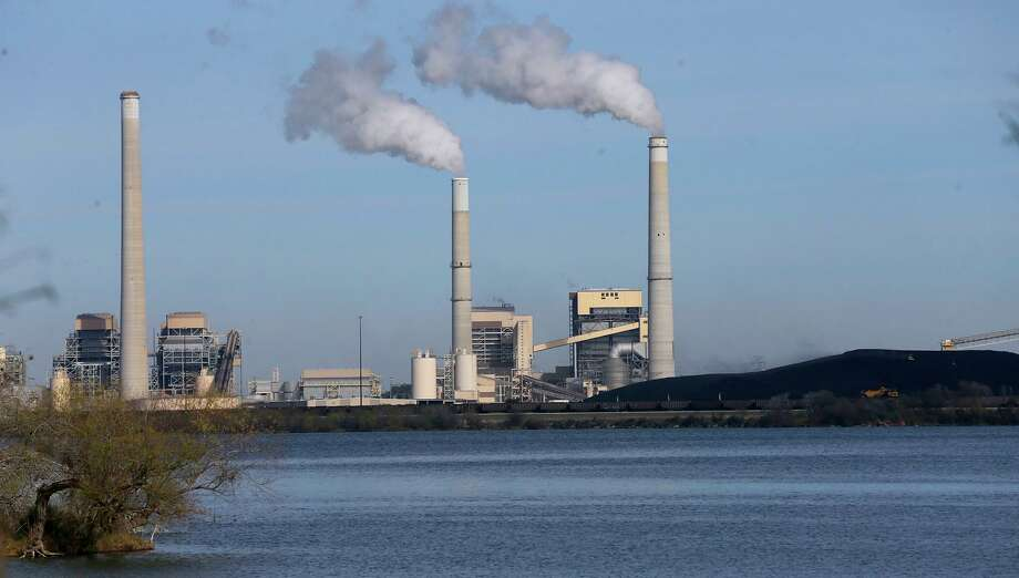CPS Energy's coal-fired power plants J.K. Spruce (right) and Deely (left stack) on Calaveras Lake Thursday January 4, 2018. A plan passed by City Council Thursday to tackle local carbon emissions does not mention CPS' two coal-fired power plants Spruce One and Spruce Two. Photo: Express-News File Photo / ©John Davenport/San Antonio Express-News