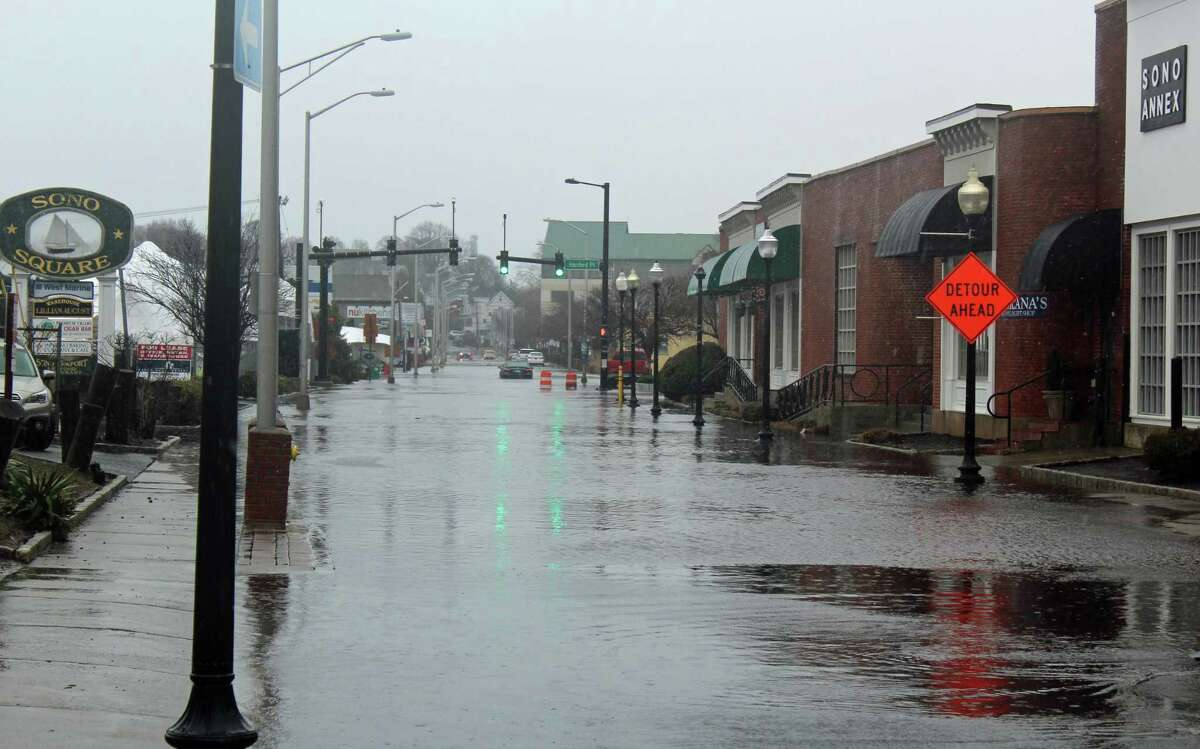 Water Street flooded long before the 11:30 a.m. high tide Friday. One car got stuck in the flooded roadway.