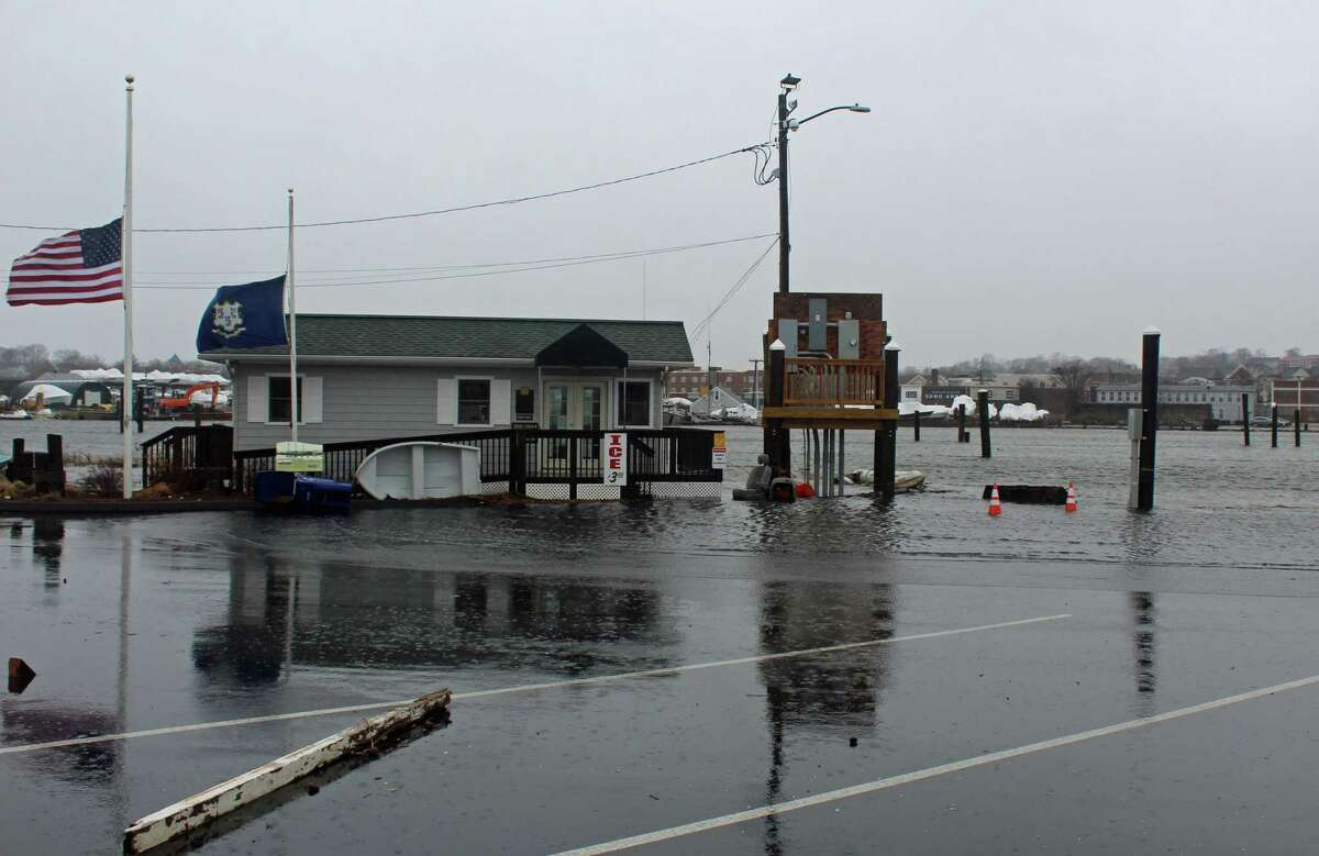 The parking lot and road at the Visitor Docks at Veterans Memorial Park flooded during the high tide of Friday's storm.