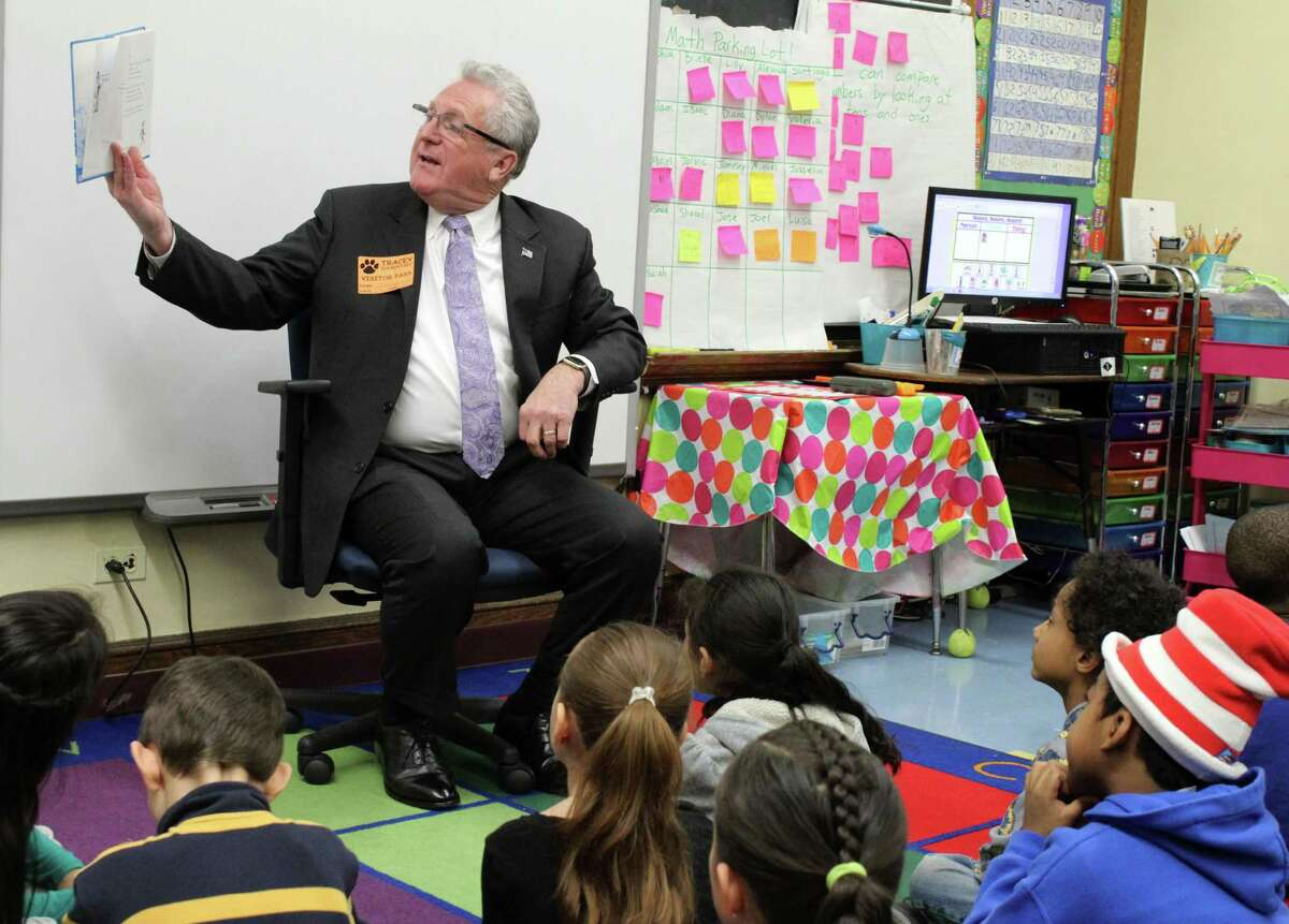 Norwalk Mayor Harry Rilling reads to a first-grade class at Tracey Elementary School on Friday, March 2, to celebrate National Read Across America Day.