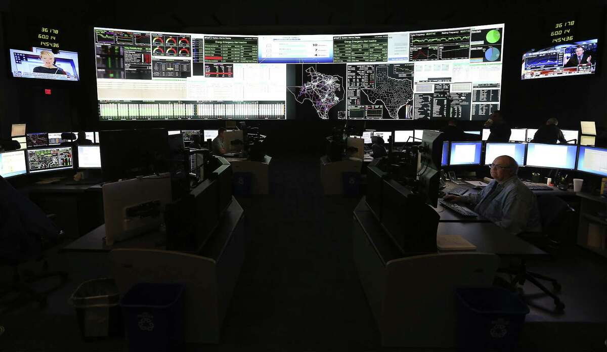The control room of Texas' grid operator, the Electric Reliability Council of Texas (ERCOT), shows the status of the grid and potential spots of concern.