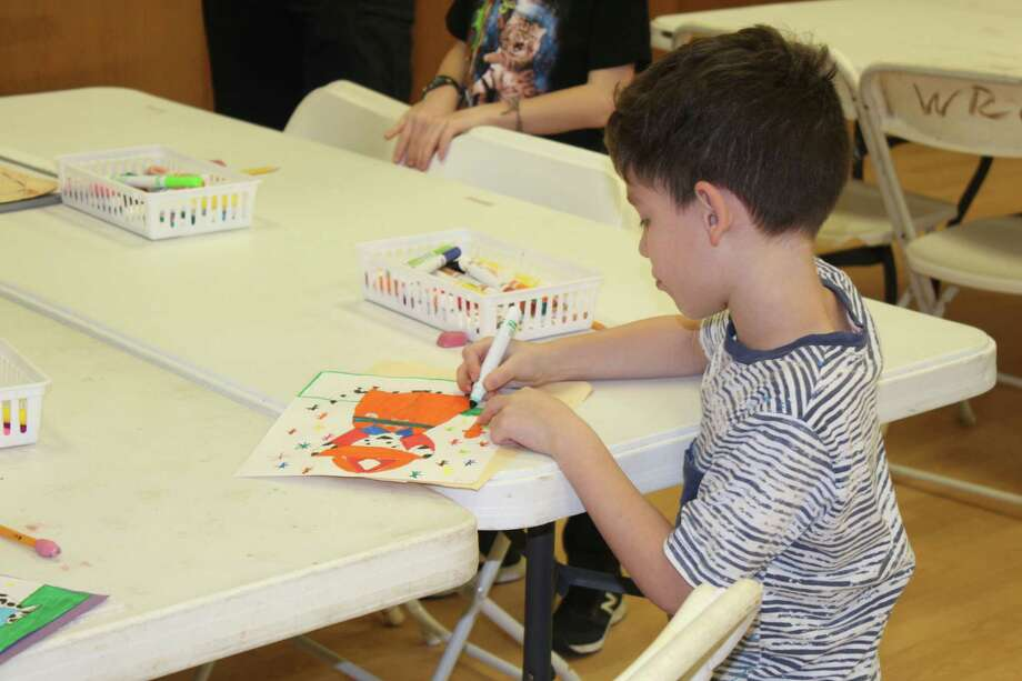 Children drew pictures of dalmatians while listening to local firefighters explain their role in the community during a Young Rembrandts free art and educational class honoring local heroes on Feb. 26 at theRecreation Center at Rob Fleming Park. Photo: Staff Photo By Patricia Dillon