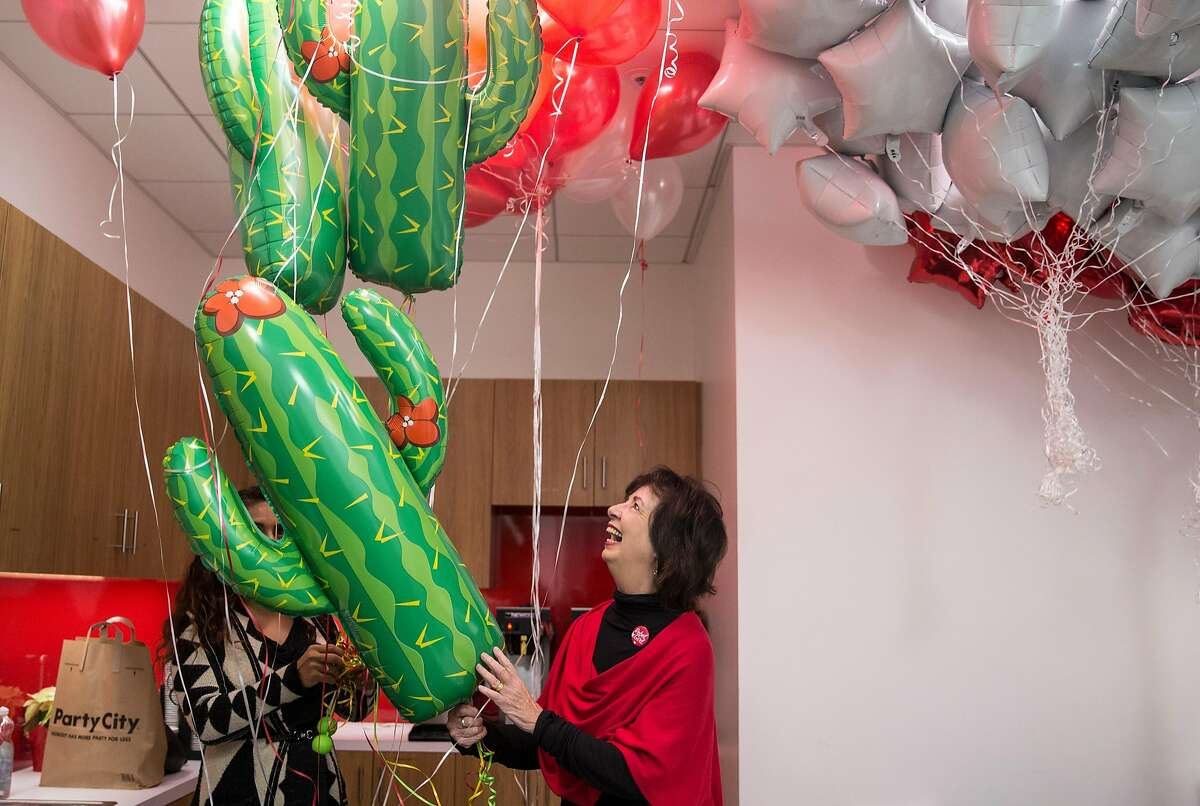 Executive Director of the California Nurses Association and National Nurses United RoseAnn DeMoro admires a bouquet of cactus balloons before her retirement party held after 32 years of service at the CNA-NNU Headquarters Friday, March 2, 2018 in Oakland, Calif.