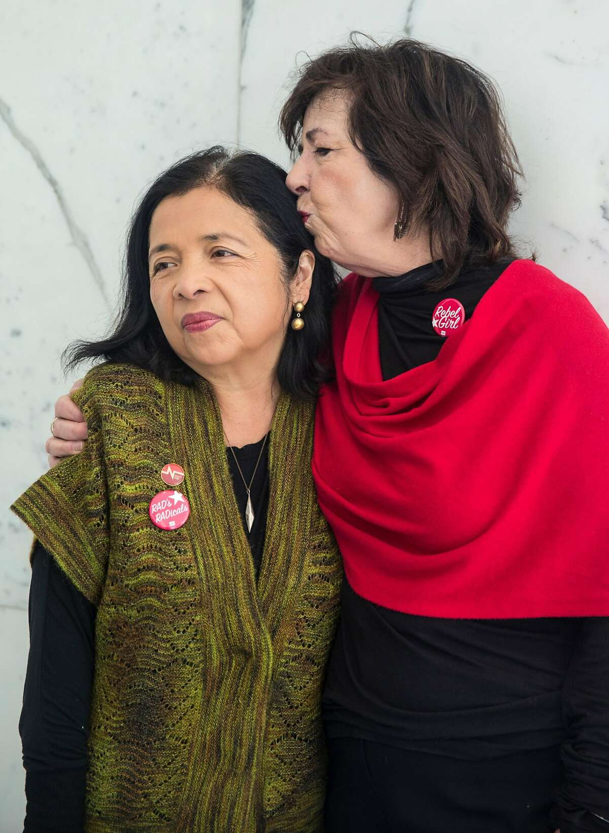 Executive Director of the California Nurses Association and National Nurses United RoseAnn DeMoro, right, kisses Associate Executive Director of the California Nurses Association and National Nurses United Bonnie Castillo before a retirement party held for DeMoro at the CNA-NNU Headquarters Friday, March 2, 2018 in Oakland, Calif.