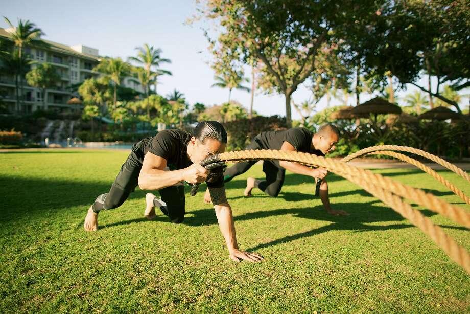 Kiakahi sessions include work with battle ropes. Photo: Anna Kim Photography