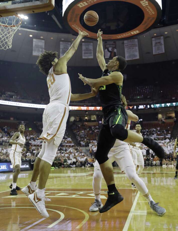 Baylor forward Tristan Clark, right, shoots over Texas forward Jericho Sims (20) during the first half of an NCAA college basketball game, Monday, Feb. 12, 2018, in Austin, Texas. (AP Photo/Eric Gay) Photo: Eric Gay, STF / Associated Press / Copyright 2018 The Associated Press. All rights reserved.