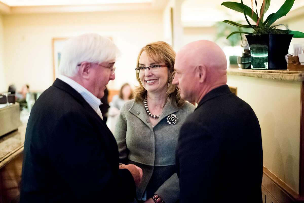 Investor and philanthropist Ron Conway, left, speaks with former U.S. Representative Gabrielle Giffords and her husband, astronaut Mark Kelly, on Wednesday, Feb. 28, 2018, in San Francisco.