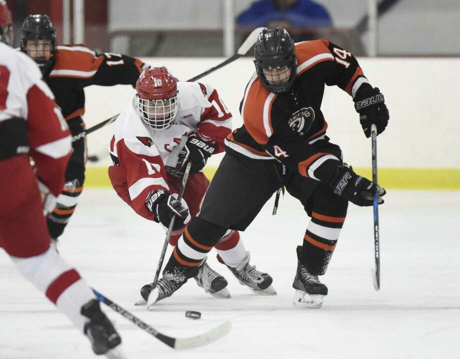 Greenwich's Sean Pratley (10) and Ridgefield's Will Forrest battle for the puck in Greenwich's 5-3 win on Feb. 19 at Dorothy Hamill Skating Rink in Greenwich. The two teams will meet again today in Darien for the FCIAC championship. Photo: Tyler Sizemore / Hearst Connecticut Media / Greenwich Time