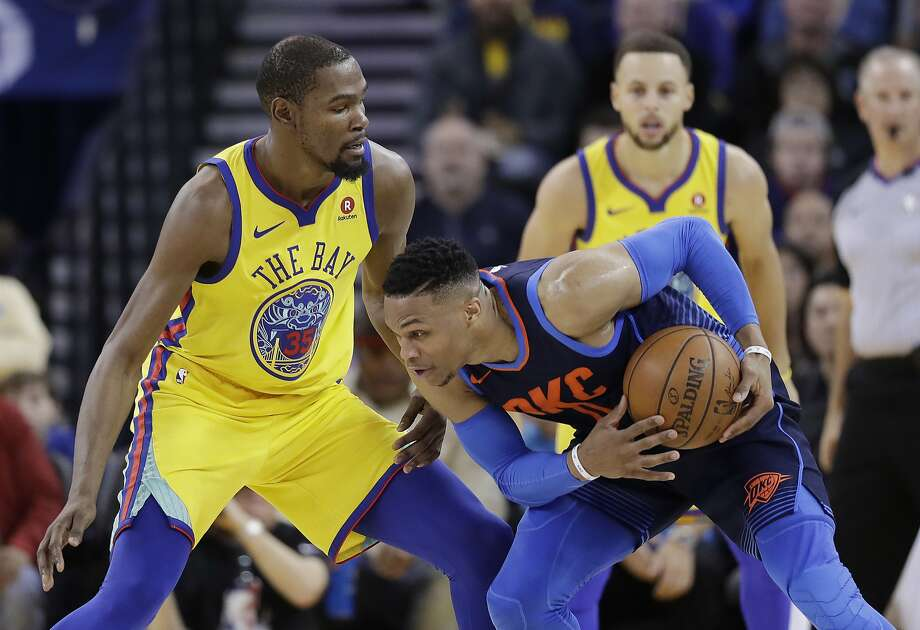 Golden State Warriors' Kevin Durant, left, defends on Oklahoma City Thunder's Russell Westbrook during the second half of an NBA basketball game Saturday, Feb. 24, 2018, in Oakland, Calif. (AP Photo/Marcio Jose Sanchez) Photo: Marcio Jose Sanchez, Associated Press