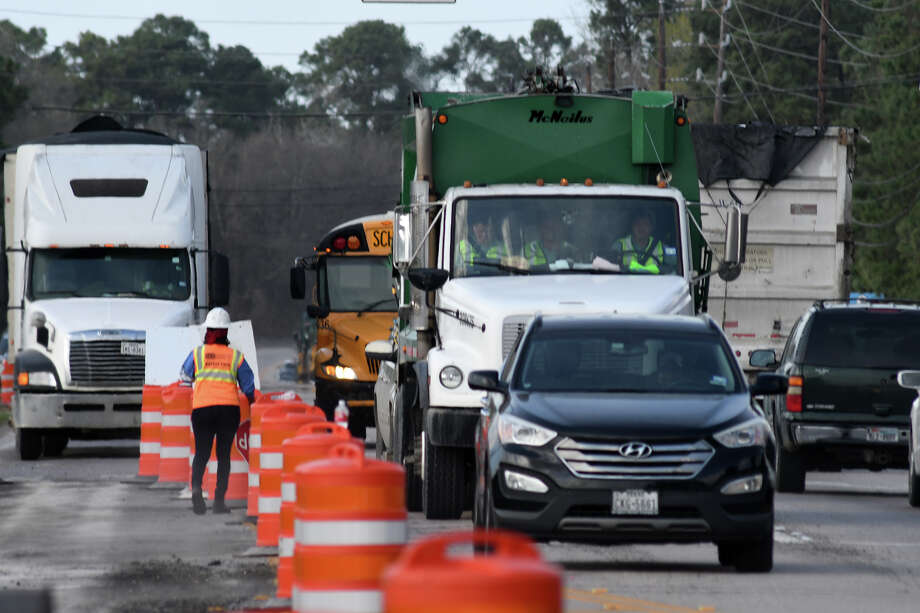 A road construction crew works at the intersection of Wilson Road and Loggia Lane in Humble on Feb. 28, 2018. (Photo by Jerry Baker/Freelance) Photo: Jerry Baker, Freelance / Freelance