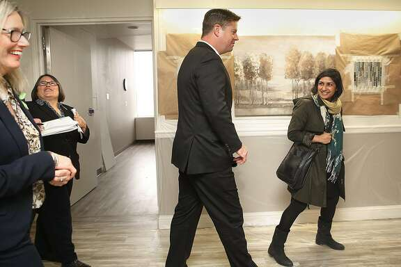Executive VP of operations for Crestwood Behavioral Health, Patty Blum (far left), Ph.D., takes Mayor Mark Farrell (middle) and Aneeka Chowdry (right) on a tour of the Crestwood Healing Center consisting of 54 psychiatric beds for severely mentally disabled homeless patients at St. Mary's hospital on Friday, March 2, 2018, in San Francisco, Calif.