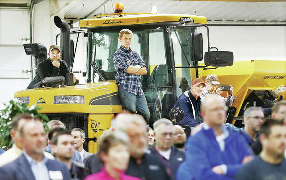 Some of the nearly 400 people stood on farm equipment inside the TriCounty FS Inc. facility on East County Road in Jerseyville Friday after showing up to hear about the major economic announcement of a new 1,400 acre rail-served logistics park to be built nearby. Construction will start on the long-negotiated project as early as late this spring or early summer and is expected to create 1,000 permanent jobs. The facility will me managed by the Kansas City Southern Railroad. Photo: John Badman | The Telegraph