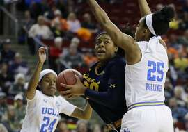 California center CJ West, center, is pressured by UCLA forward Monique Billings, right, during the first half of an NCAA college basketball game in the quarterfinals of the Pac-12 Conference women's tournament Friday, March 2, 2018, in Seattle. (AP Photo/Ted S. Warren)