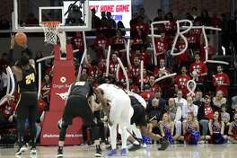 Wichita State center Shaquille Morris (24) shoots free throws as SMU fans remind viewers of the FBI investigation of bribery. It's not as if paying players is a new issue in major college athletics. The system under which they play is both unrealistic and unfair.