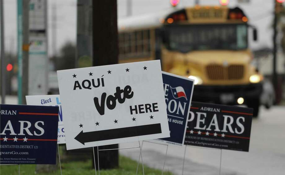 FILE - In this March 2, 2018, file photo, signs mark a polling site as early voting begins, in San Antonio. Democrats in Texas are early voting in bigger numbers ahead of the nation's first primary elections of the 2018 midterms. Turnout figures released Thursday, Feb. 22, 2018, shows more Democrats casting ballots than Republicans since early voting began this week in the nation's biggest conservative state. (AP Photo/Eric Gay, File) Photo: Eric Gay, STF / Associated Press / Copyright 2018 The Associated Press. All rights reserved.