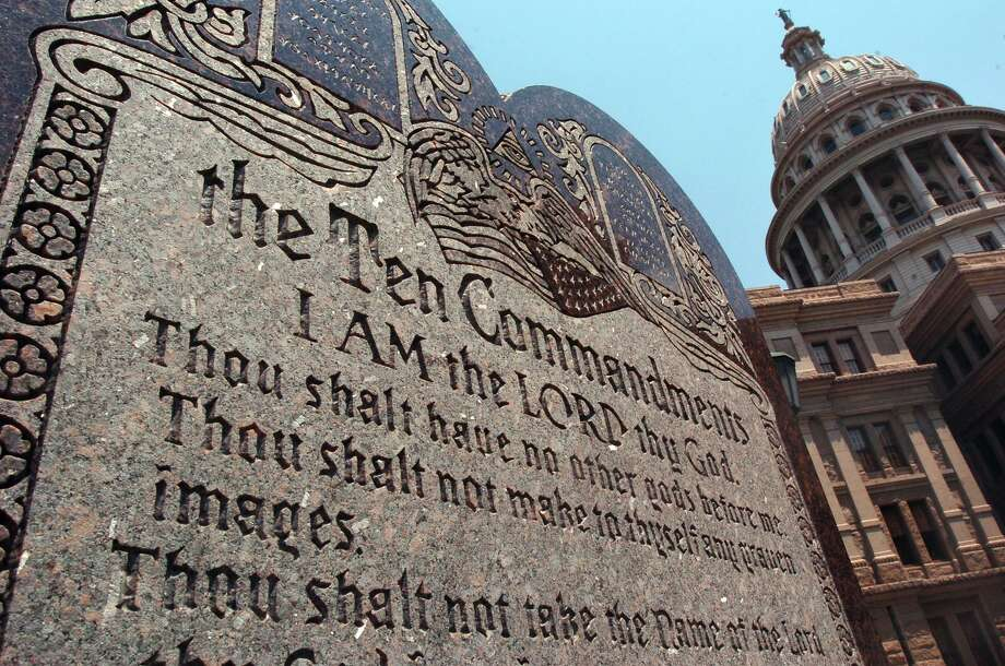 The slab displaying the Ten Commandments rests behind the north side of the Capitol building in Austin. A bill would allow the commandments also in Texas classrooms. Photo: TOM REEL /SAN ANTONIO EXPRESS-NEWS / SAN ANTONIO EXPRESS-NEWS
