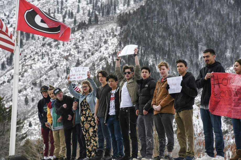 In Colorado, Glenwood Springs High School students take part in a walkout and demonstration during lunch  in support of the Parkland, Fla., shooting victims and against the NRA. For such a movement to be sustainable, activists must avoid clichés and focus on substance. Photo: Chelsea Self /Associated Press / ©ChelseaSelf