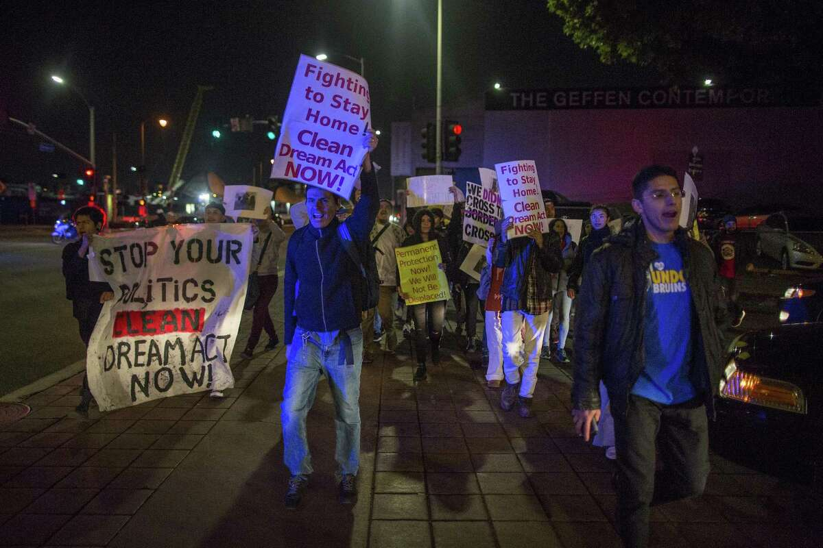 Youth immigrants known as Dreamers, children who grew up in the United States after arriving with their undocumented parents, march to the Metropolitan Detention Center, where undocumented immigrants are detained on Wednesday in Los Angeles, California.