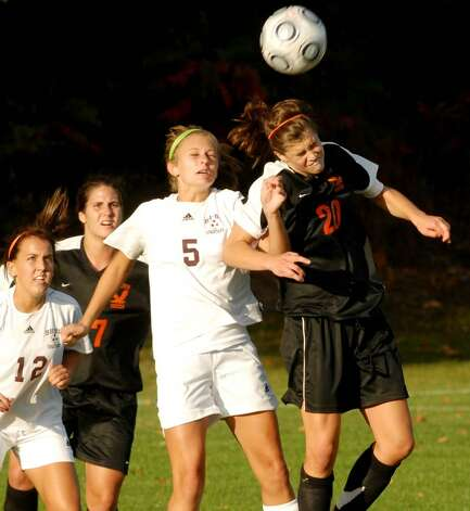 Burnt Hills' Nicole Shively, center, jumps for a head ball against Bethlehem's Kaitlyn Martin. (Luanne M. Ferris / Times Union) Photo: LMF / 00005599A