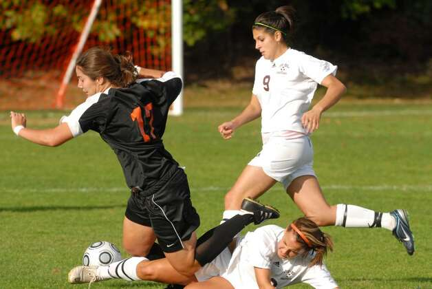 Bethlehem's Kristina Maksuti, left, is tripped up by Burnt Hills' Nichole DeCresente. (Luanne M. Ferris / Times Union) Photo: LMF / 00005599A
