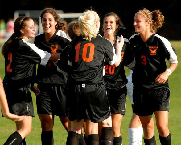 Bethlehem's Kaitlyn Martin, second from right, celebrates after she scored a goal against Burnt Hills. (Luanne M. Ferris / Times Union) Photo: LMF / 00005599A