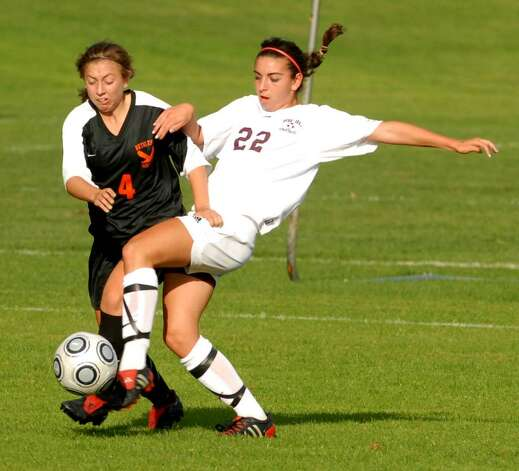 Bethlehem's Kelly Van Deusen, left, fights for control against Burnt Hills' Danielle Pedone.  (Luanne M. Ferris / Times Union) Photo: LMF / 00005599A