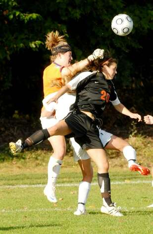 Bethlehem's Kaitlyn Martin, right, collides with Burnt Hills goalie Emily McNutt. (Luanne M. Ferris / Times Union) Photo: LMF / 00005599A
