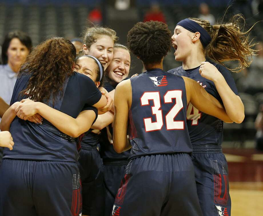 Members of the Veterans Memorial Patriots celebrates after defeating the Denver City Fillies 57-51 in their UIL Class 4A girls state semifinal game held Friday March 2, 2018 at the Alamodome. Veterans Memorial will play Argyle for the state championship Saturday at 7 p.m. Photo: Edward A. Ornelas, Staff / San Antonio Express-News / © 2018 San Antonio Express-News