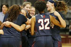 Members of the Veterans Memorial Patriots celebrates after defeating the Denver City Fillies 57-51 in their UIL Class 4A girls state semifinal game held Friday March 2, 2018 at the Alamodome. Veterans Memorial will play Argyle for the state championship Saturday at 7 p.m.
